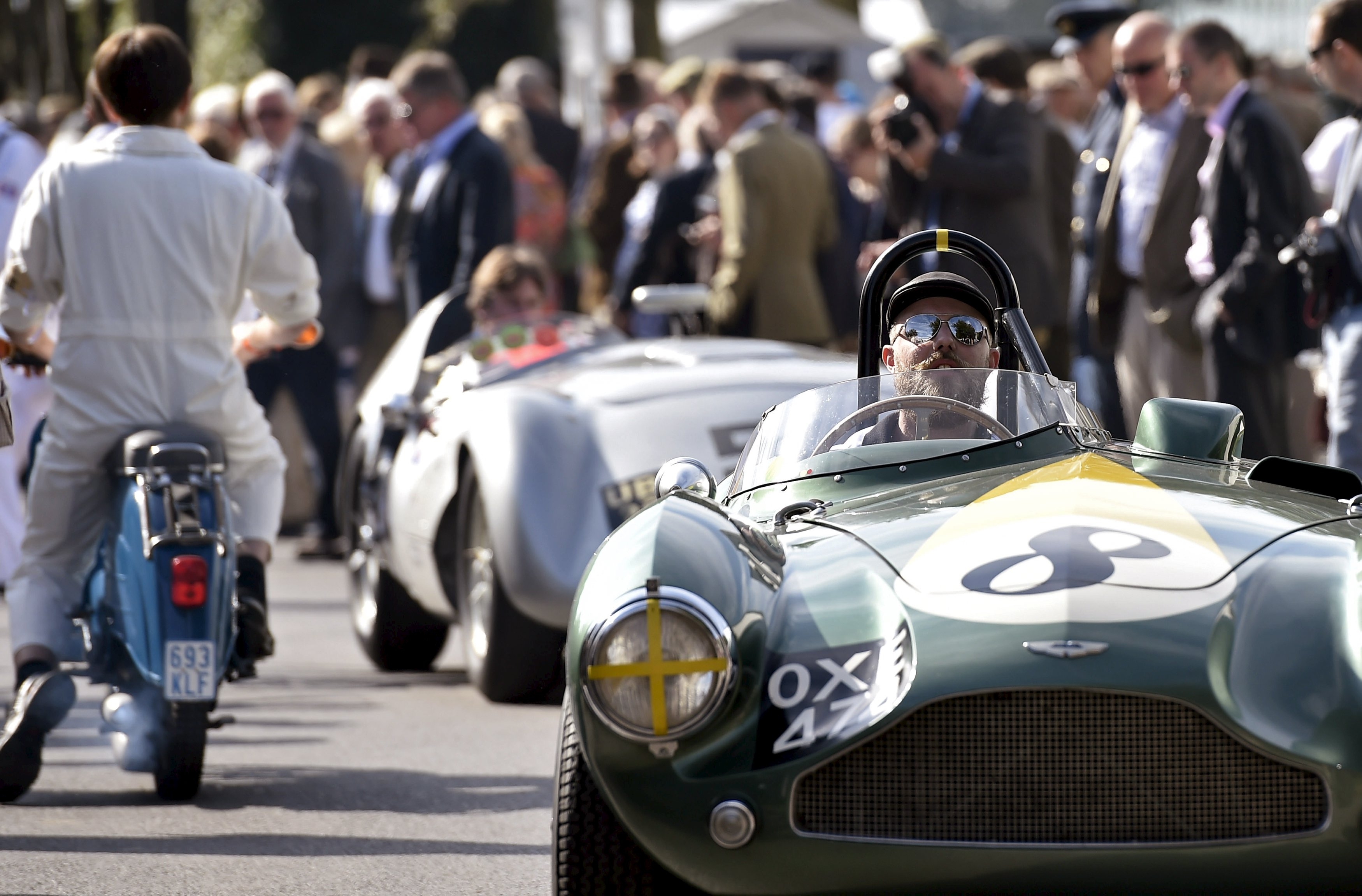 Visitors and car enthusiasts attend the Goodwood Revival historic motor racing festival in Goodwood, near Chichester in south England, Britain
